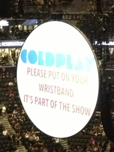 Wristband sign at Coldplay:Jay Z