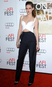 Kristen Stewart in crop top and pants