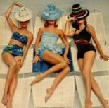 sunbathers in retro suits